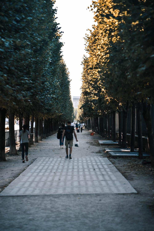 people walking near walkway running shoes