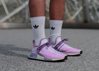 person in purple-and-gray shoes
