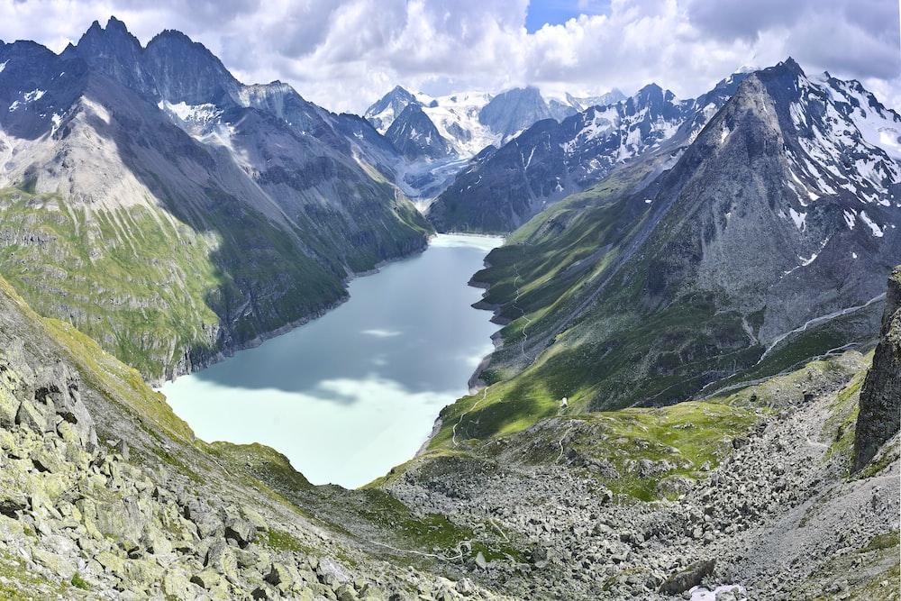 aerial photography of lake between mountain range during daytime