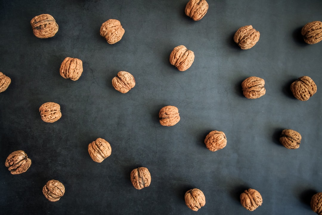 Walnut pattern on a dark marble background. All of the produce is from our farm in Mala Ivanca, Serbia. Influencer shop > https://creativemarket.com/NordWood