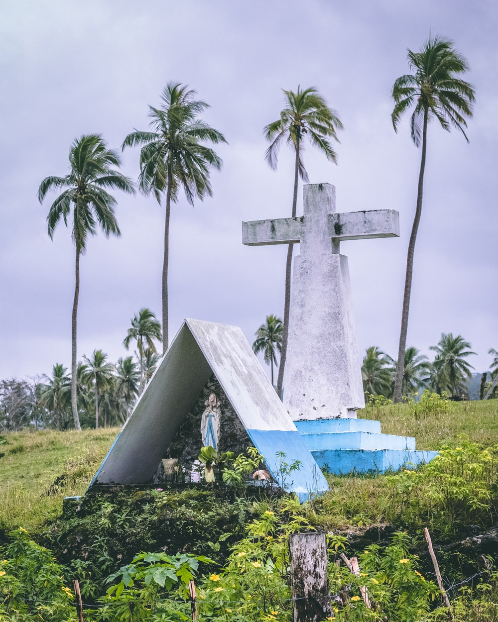 white and blue cross statue