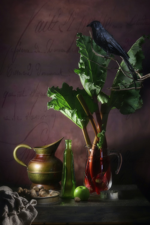 green leaf vegetables in glass pitcher