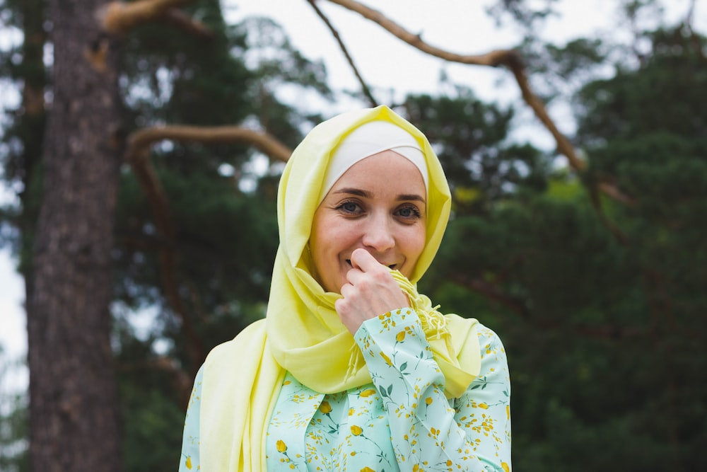 woman in yellow headscarf