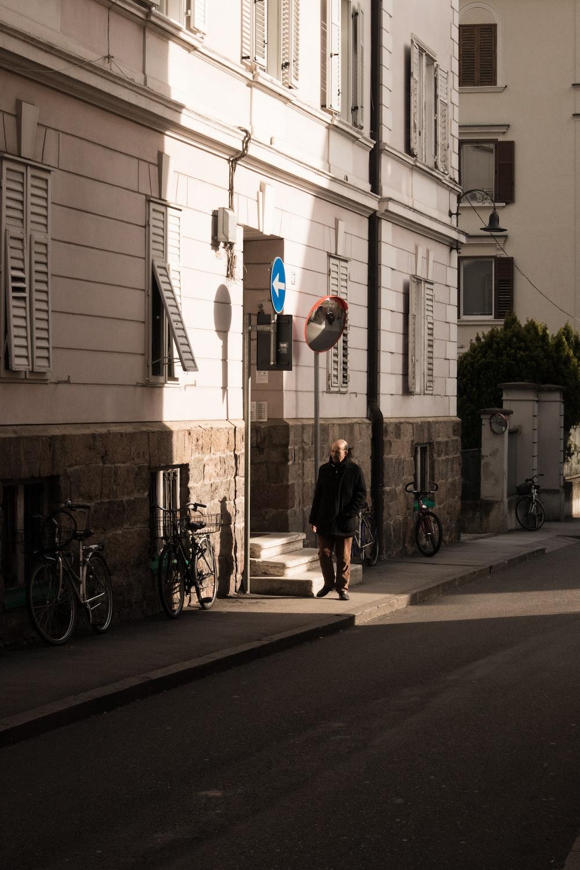 man walking beside building during daytime