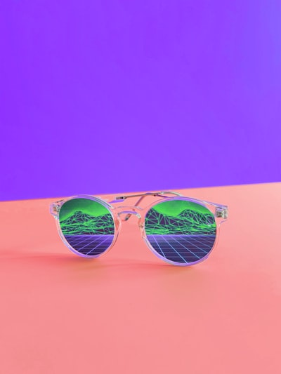Sometimes, when you go to the craft supply store and pick up some new foam core, you just wander around your apartment looking for something to shoot. A new pair of clear sunglasses with some digital images printed on them seemed to be the perfect trick.