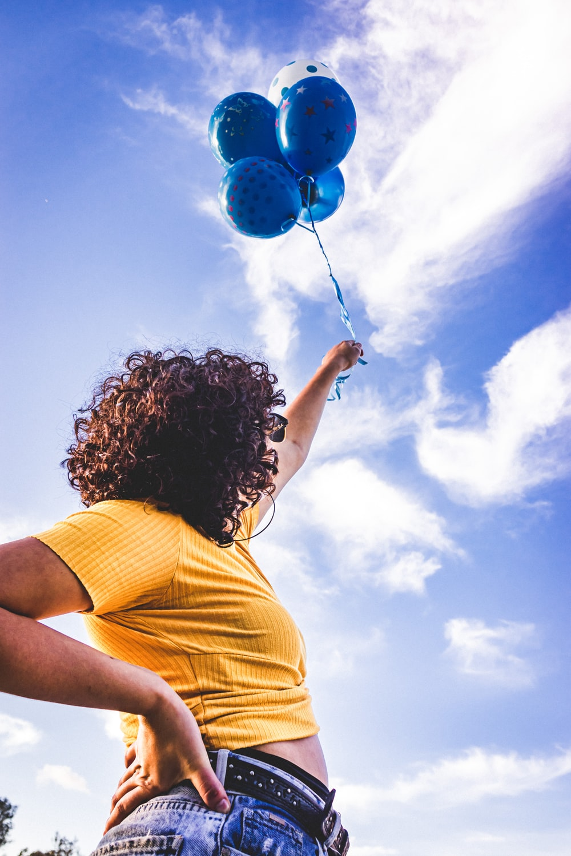 woman holding balloon during daytime