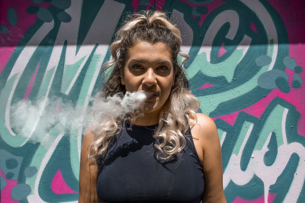 smoking woman in black halter top