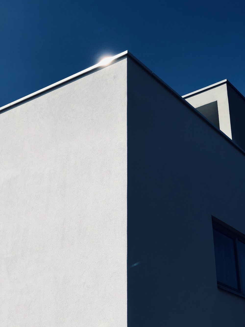 low-angle photography of concrete building under blue sky