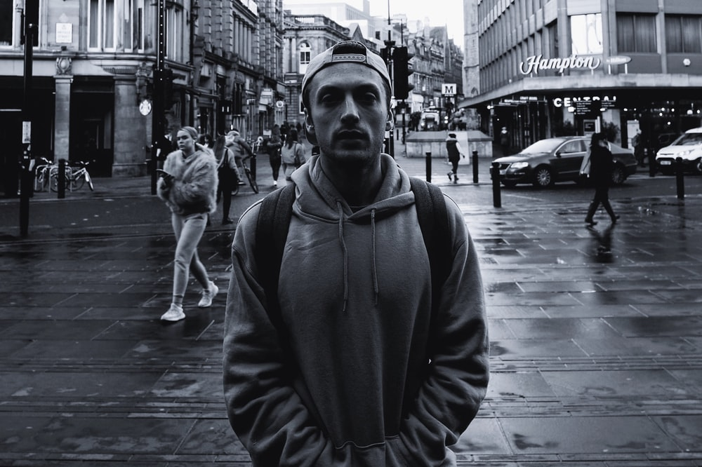 man wearing grey hooded jacket