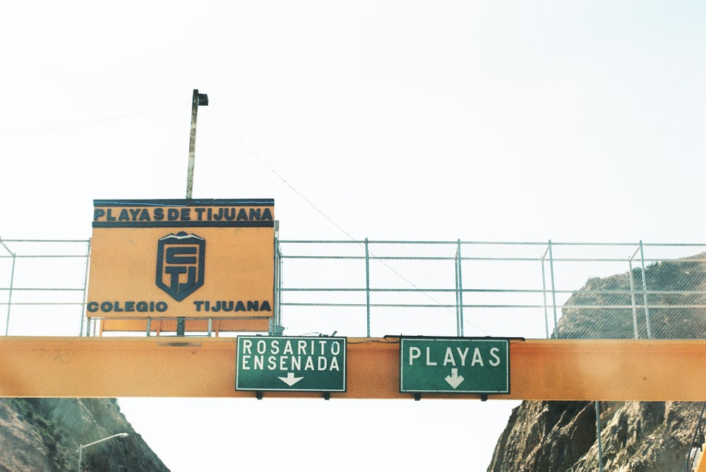 two green-and-white bridge signages