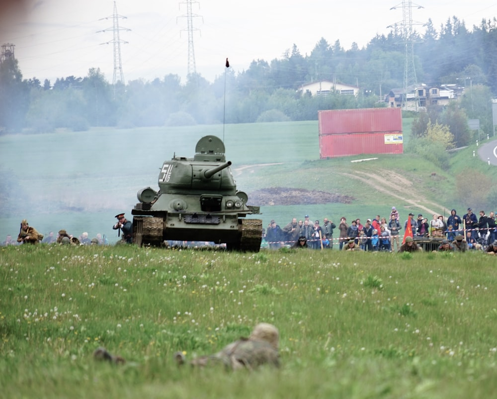 gray tank on green grass