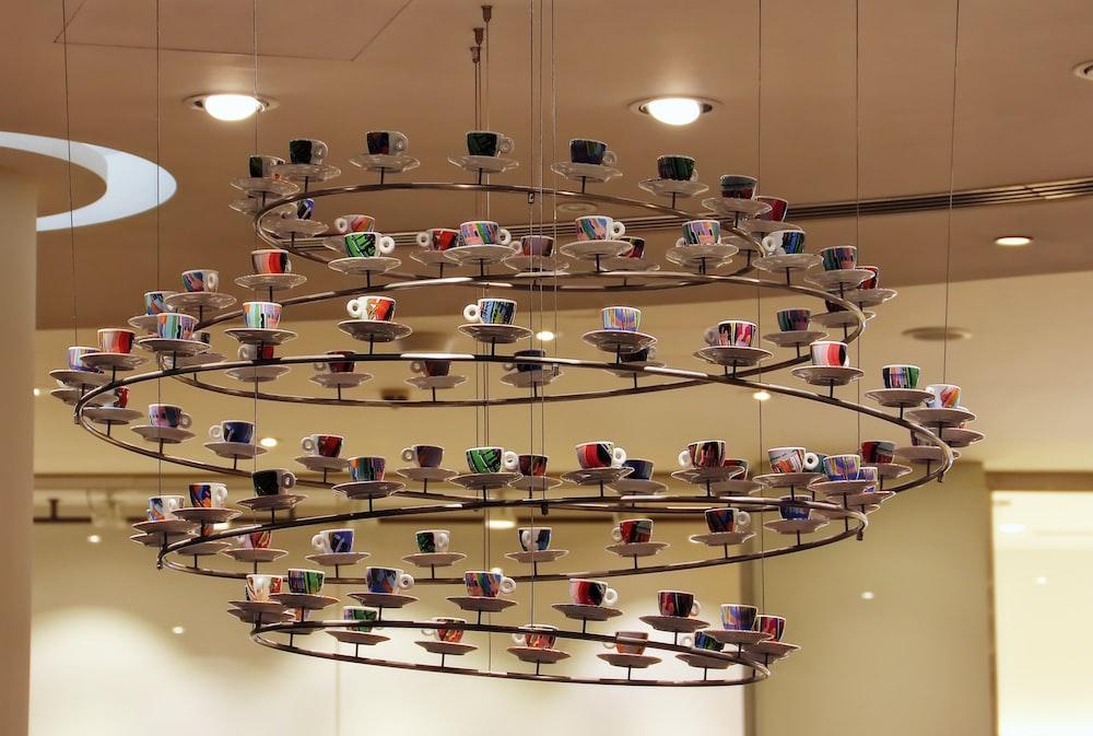 mugs on saucers on hanging decor indoors