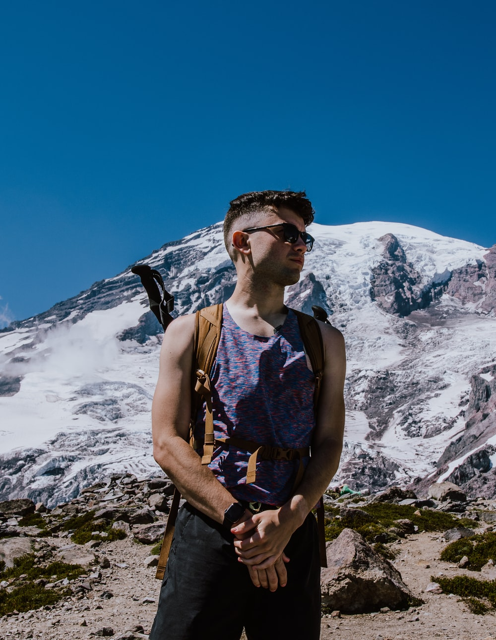 man standing in front of glacier mountain