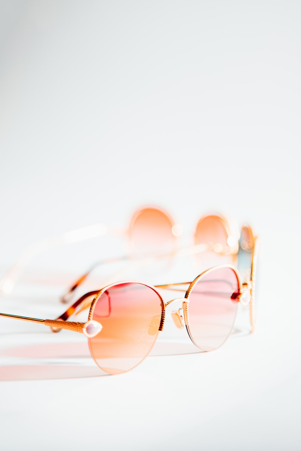 pink sunglasses with gold-colored frame