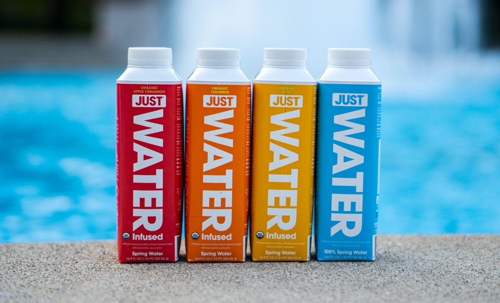 four assorted-color water bottles