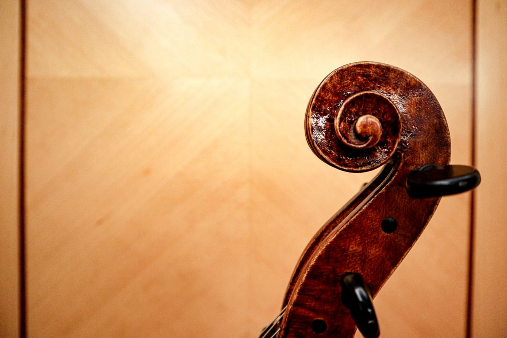 brown wooden guitar headstock