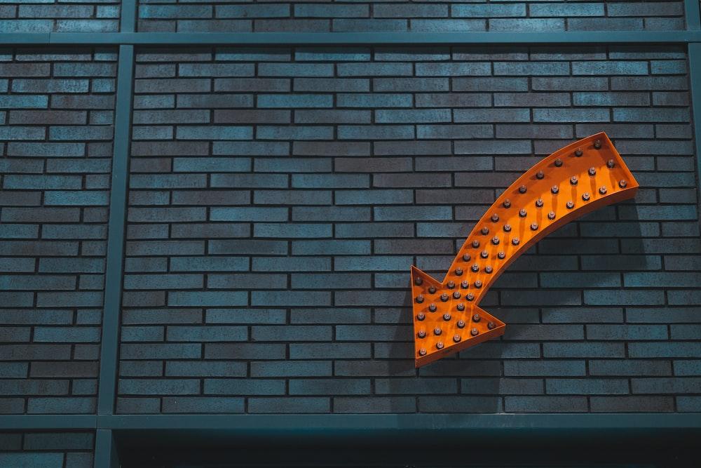 orange arrow signage