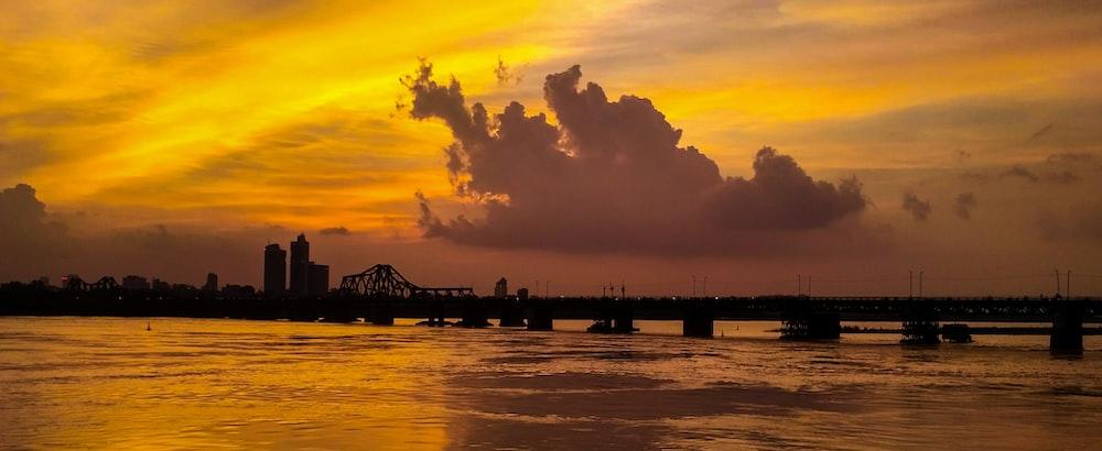 orange skies above bridge