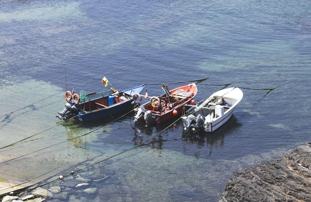 three power boats