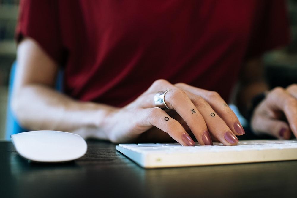 woman using Apple Mighty Keyboard