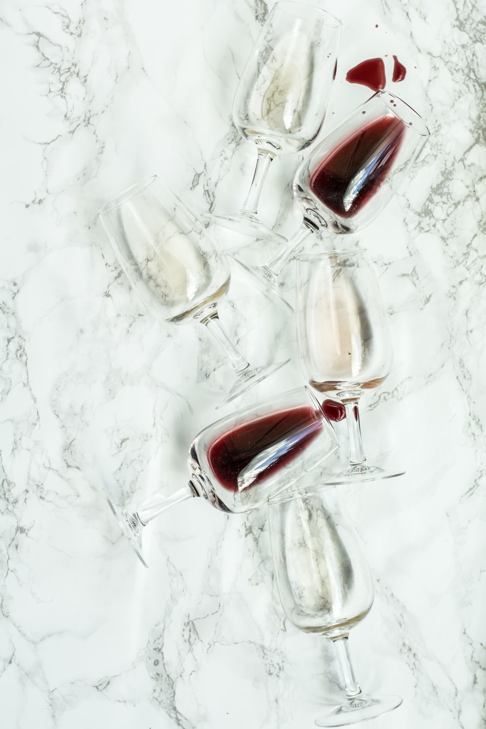 several clear wine glasses