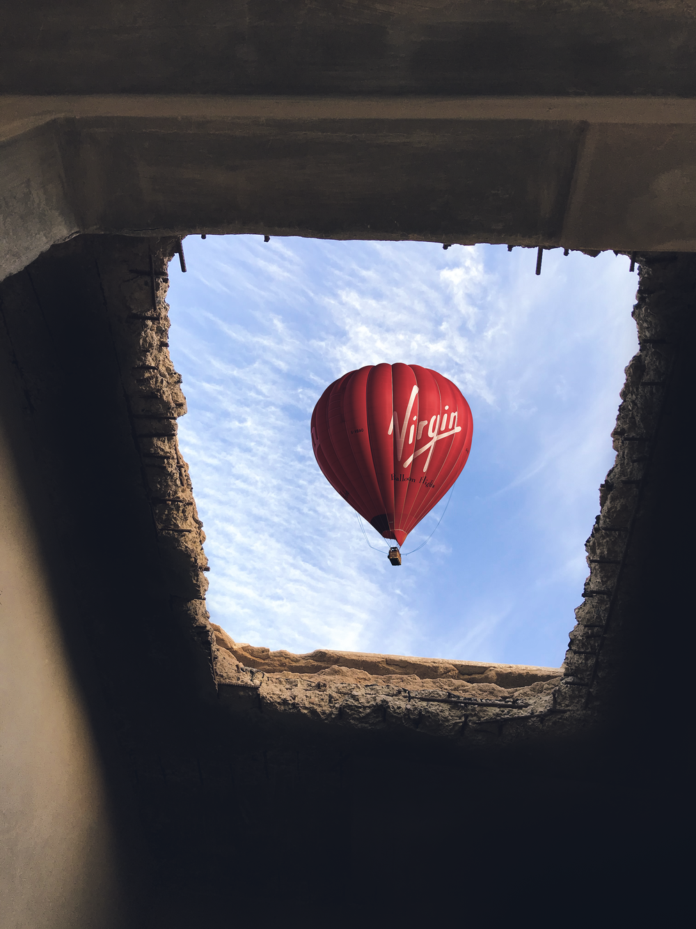 tunnel view of red hot air balloon