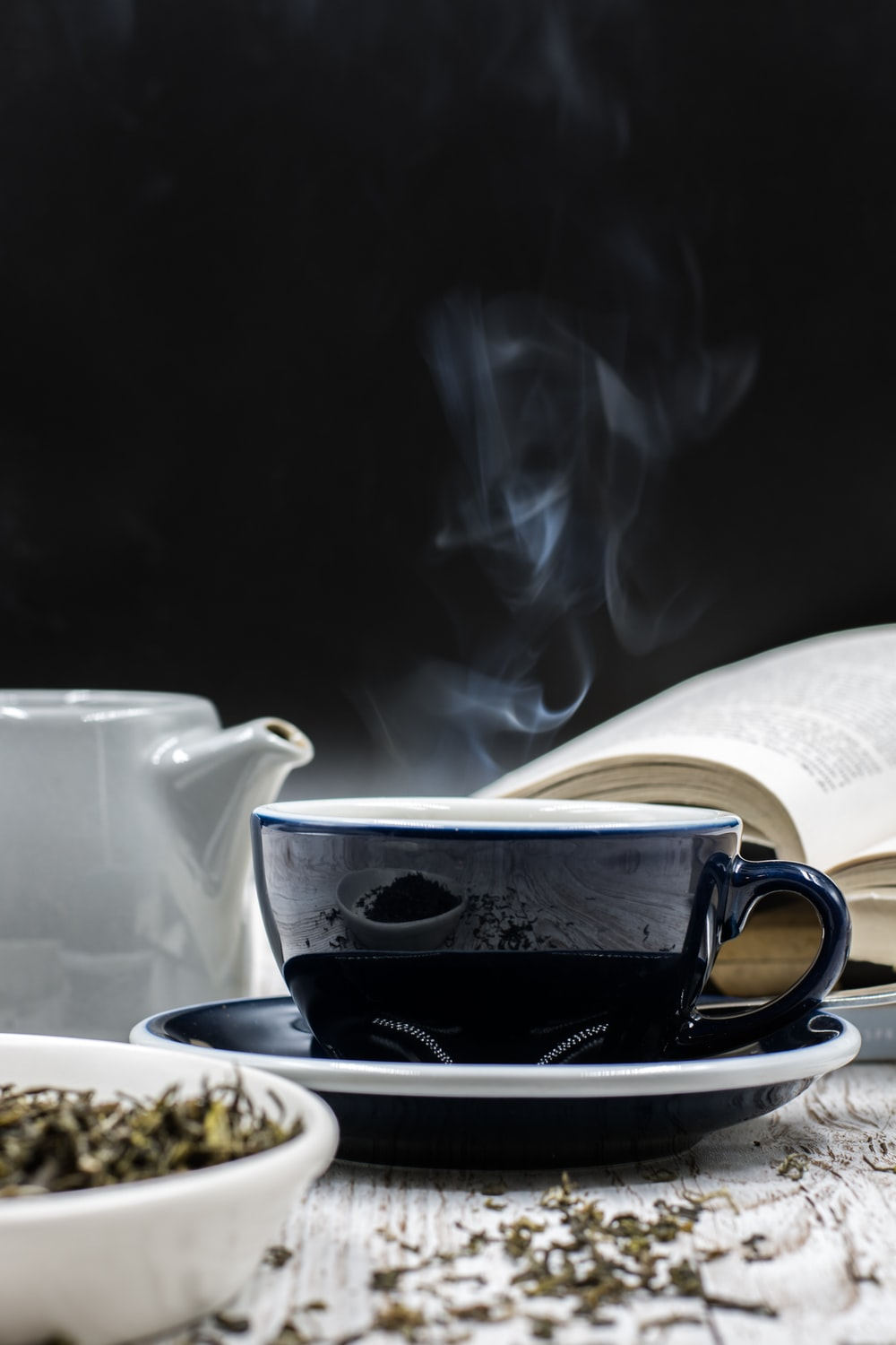 black and white ceramic cup on saucer