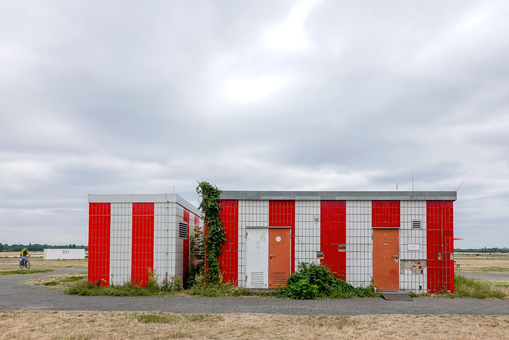 white and red striped building during daytime