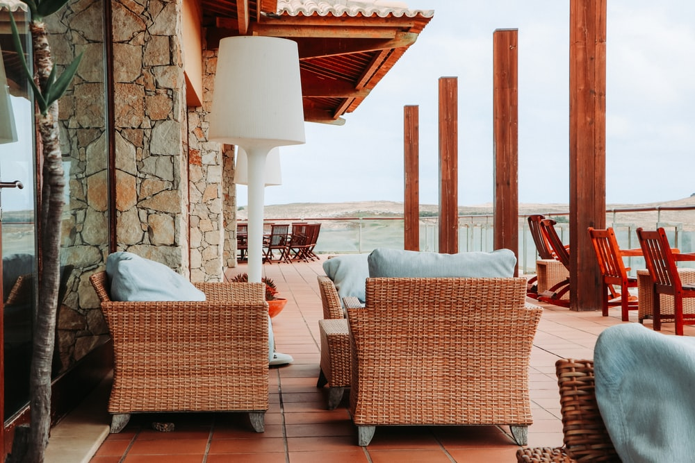 brown wicker chairs on porch during daytime