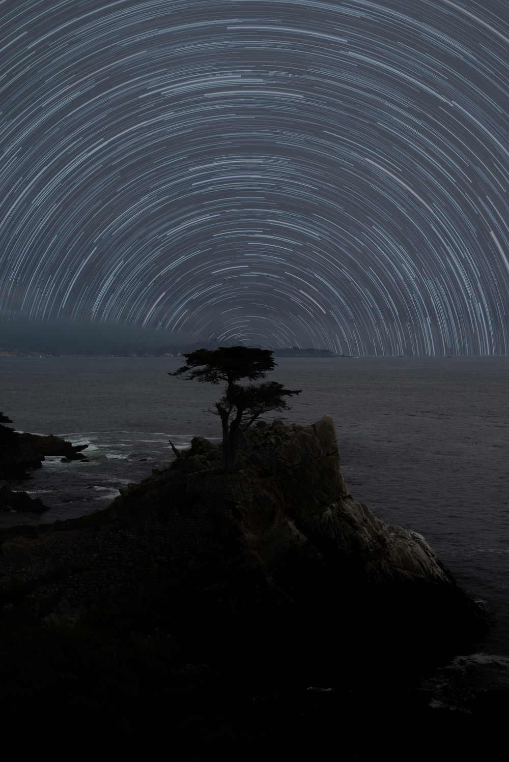 time lapsed photography of stars over the sea
