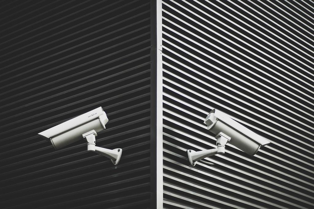 two grey CCTV security cameras