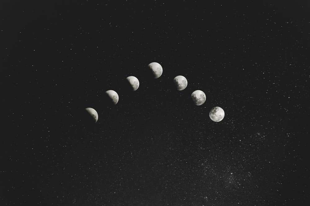 grayscale photography of seven moon illustration