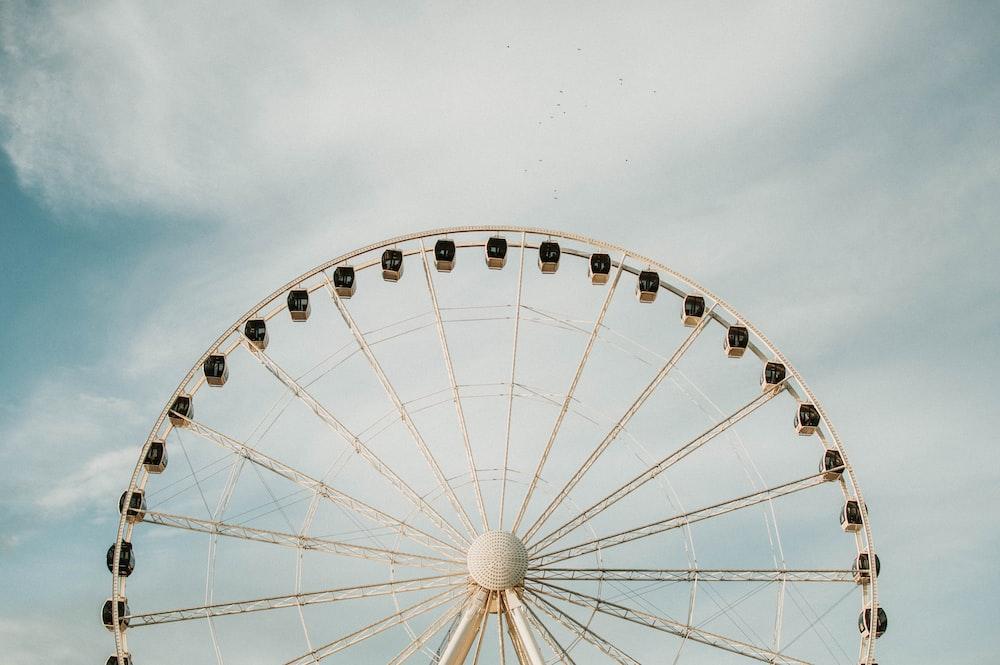 white ferris-wheel under clear blue sky