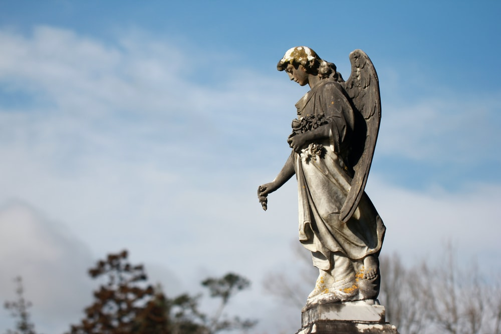 angel grey statue at daytime