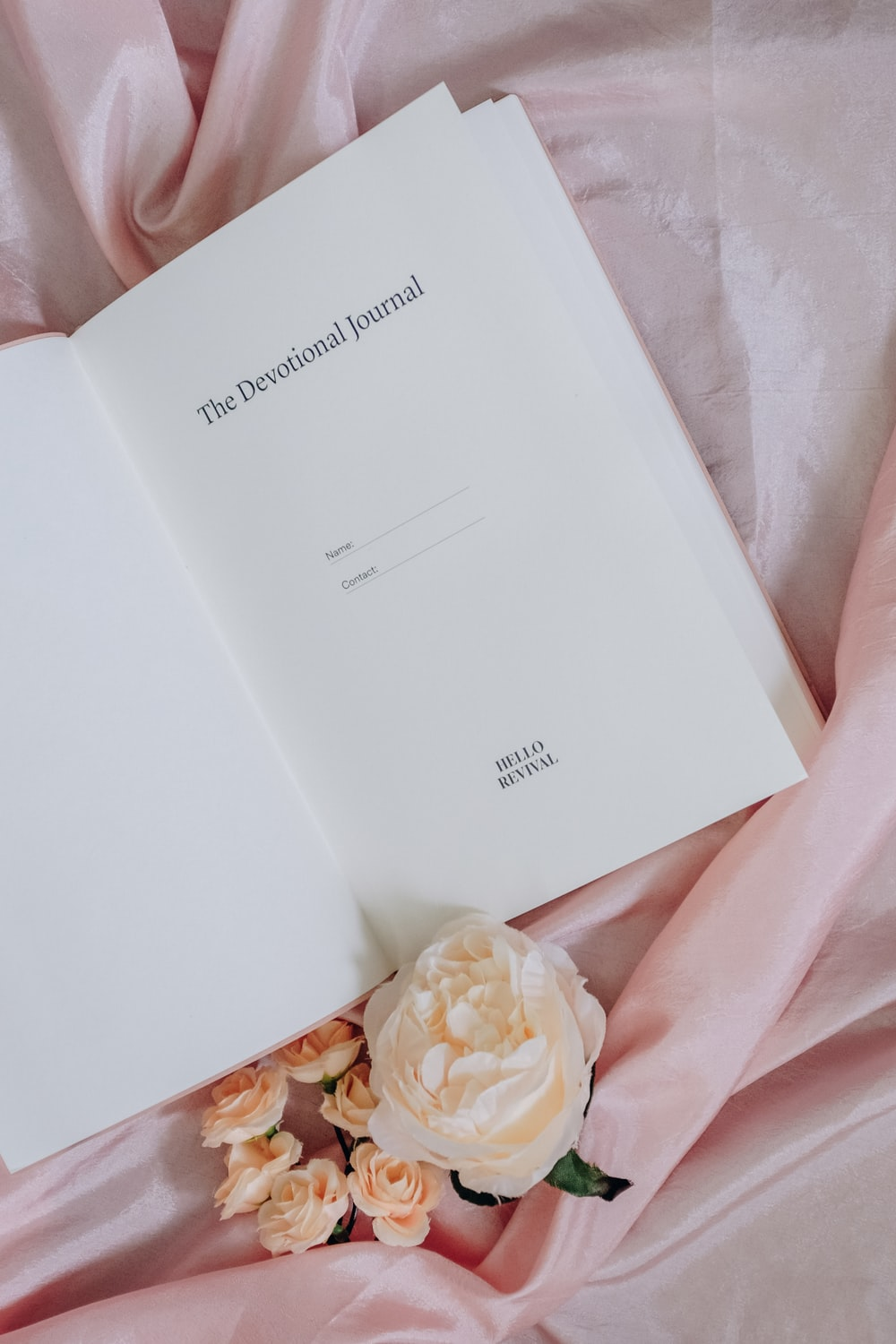 open book on pink textile
