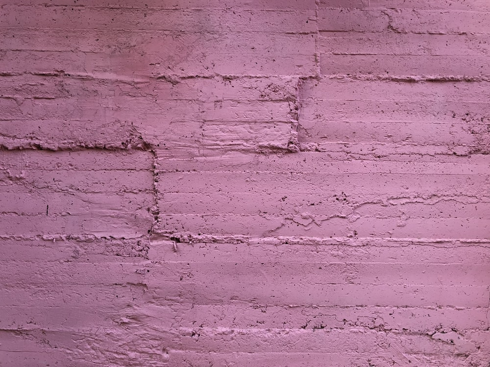 pink painted concrete wall