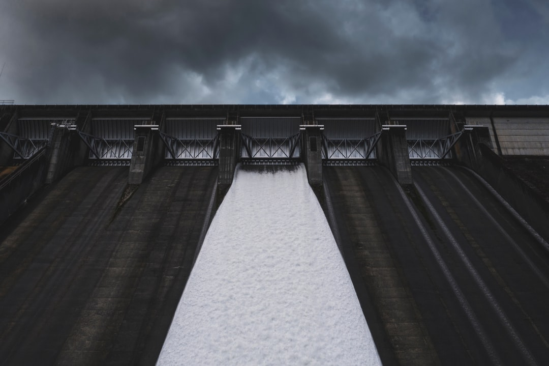 The fun thing about drones is getting to take photos from completely new perspectives. For example, here's the top half of a 400-foot-tall dam, in all its cold industrial glory, located in the foothills of the Cascade Mountains. If you look at the top you can see the doors workers use for maintenance. That gives you an idea of its massive scale.