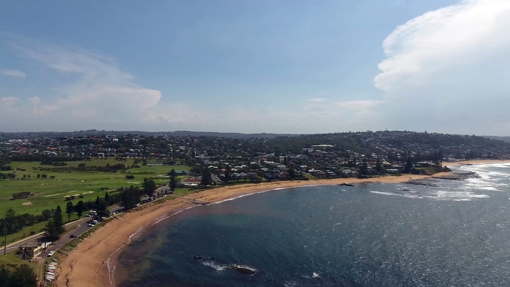 aerial photography of a cityscape by the sea during daytime