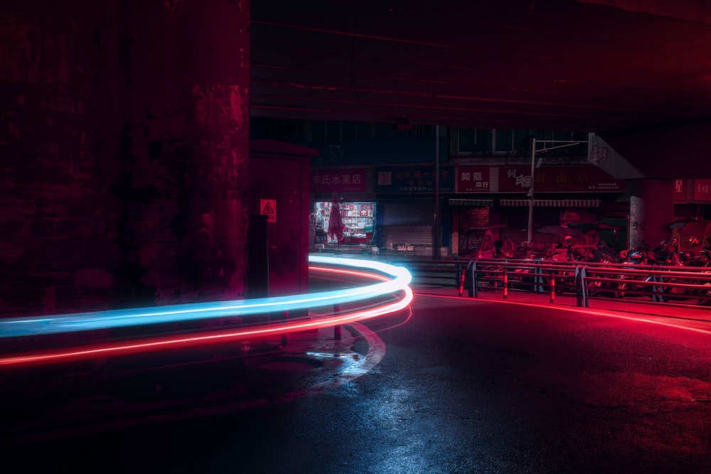 time lapse photography of curved street during nighttime