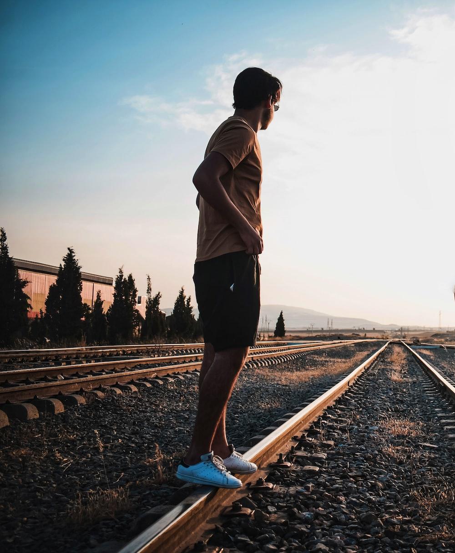 man standing on railings