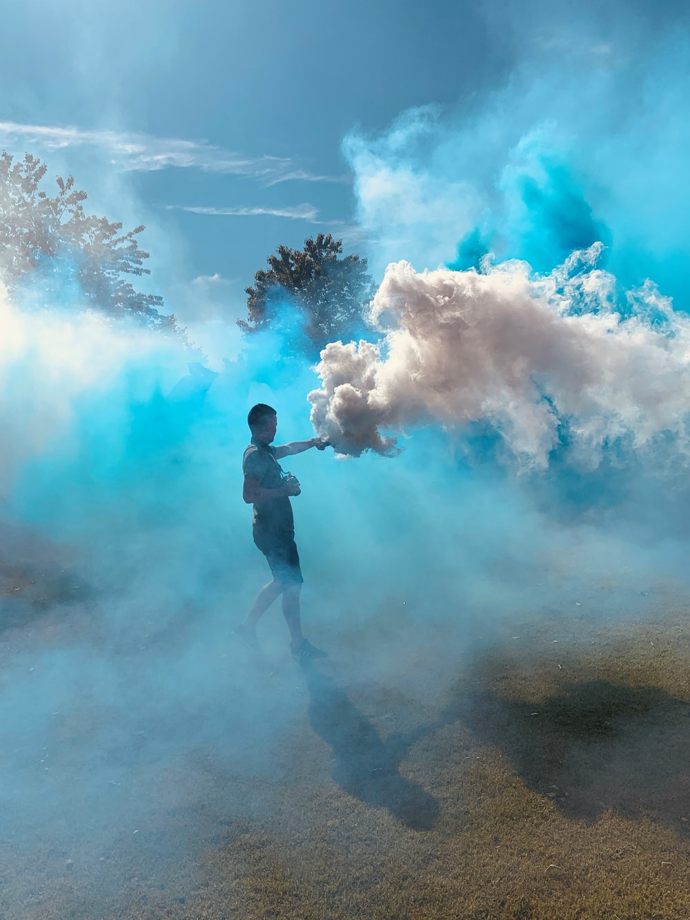 man releasing white smokes