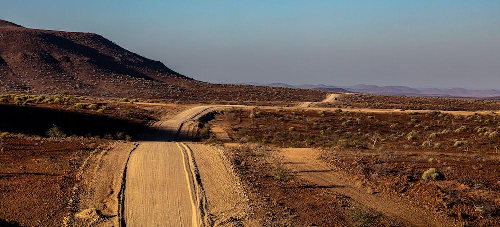 dirt road on vast land
