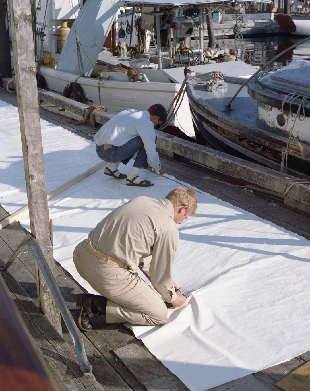 Cutting signal cloth for draping a hydrographic signal with. Operations of ESSA Ship PATTON.