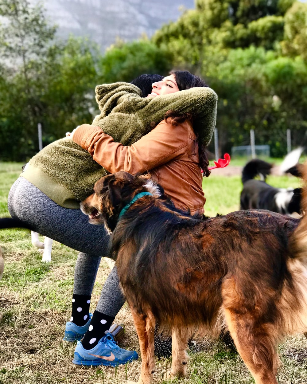 woman hugging woman