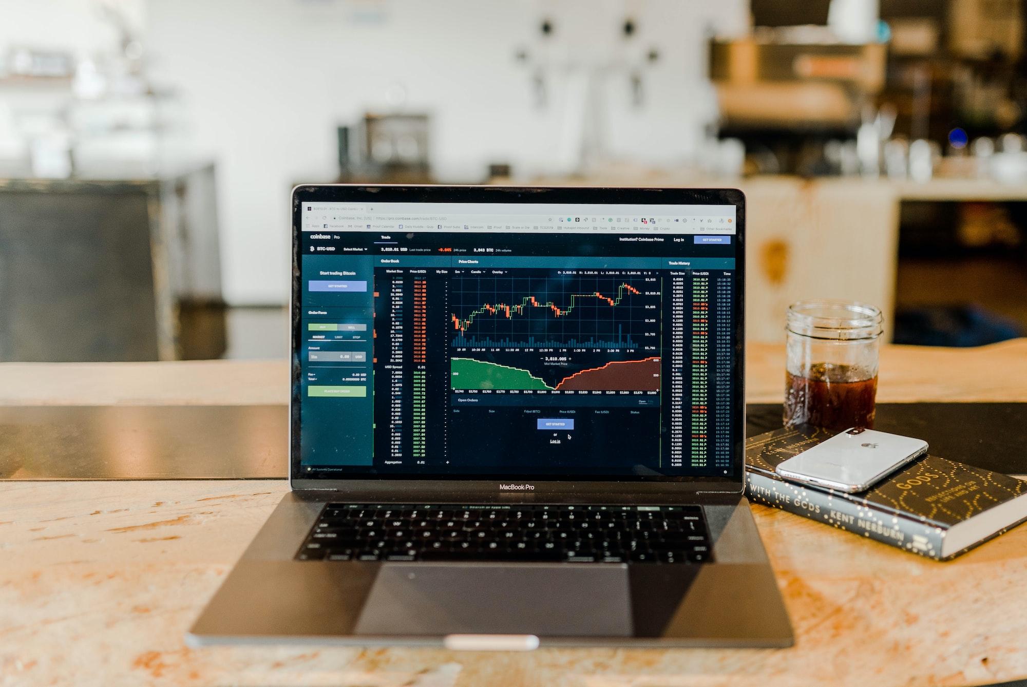 "Daytrading bitcoins financial markets at a coffeeshop.""."