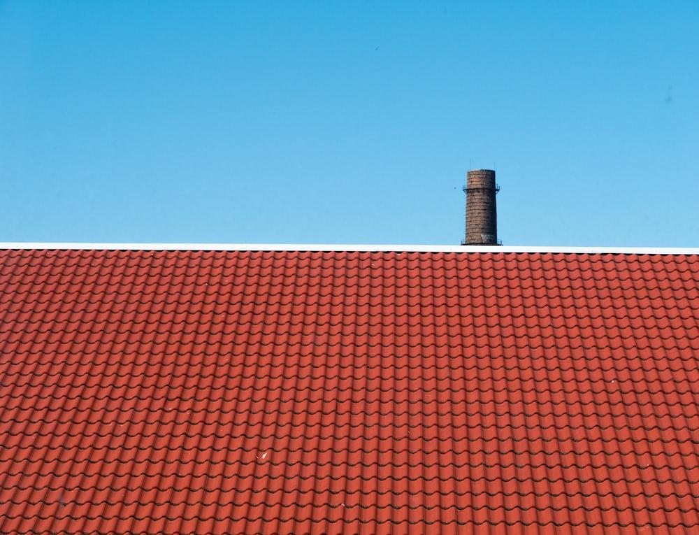 brown roof across blue sky