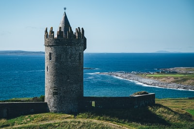 gray castle tower on mountain shore during day ireland teams background