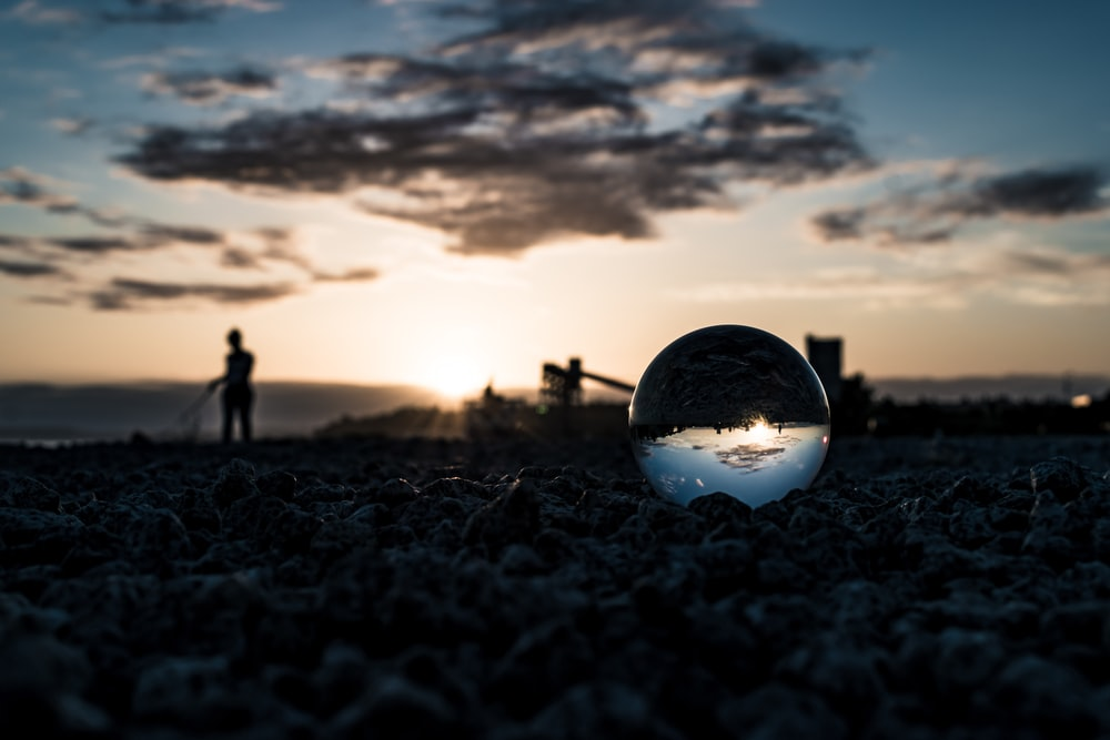 clear glass ball on shore