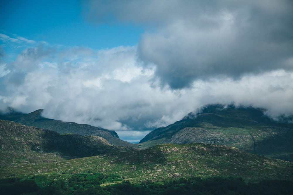 landscape photo of mountains under white fogs