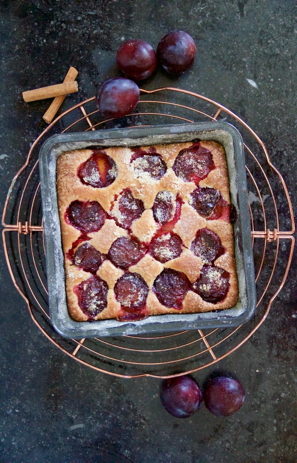 plum fruits and plum pie on black bowl